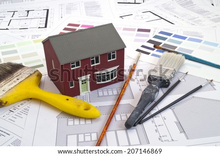 House plans, house and painting tools - stock photo