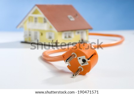 House, power cable and plug - stock photo