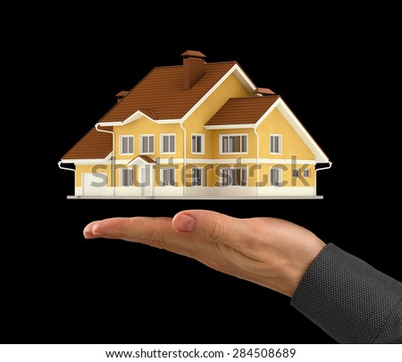 House Presentation. Miniature model of a contemporary house under the turned up palm of a men's hand. Isolated on black background scene. - stock photo
