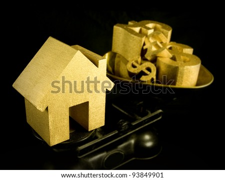 house prices, first time buyer, gold house and money symbols on scales - stock photo