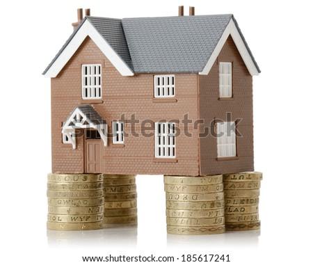 house propped up with money isolated on a white background - stock photo