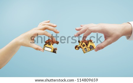 house puzzle in hands, closeup - stock photo