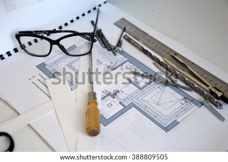 house remodel, design project of house with office tools and consruction tools on a white table - stock photo