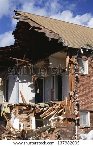 House ripped apart by natural disaster - stock photo