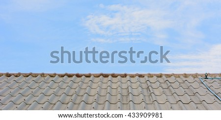 house roof against the cloudy sky