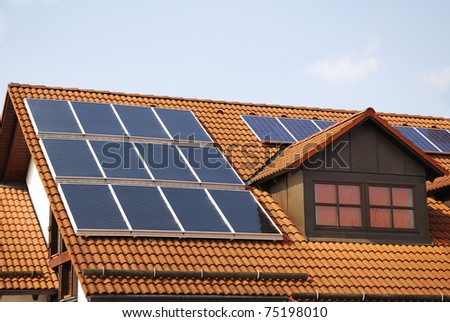 House roof with a photovoltaic system - stock photo