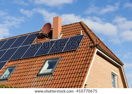 house roof with solar panels and blue sky