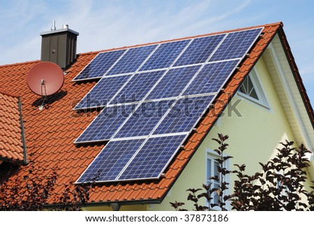 House roor with solar panels. - stock photo