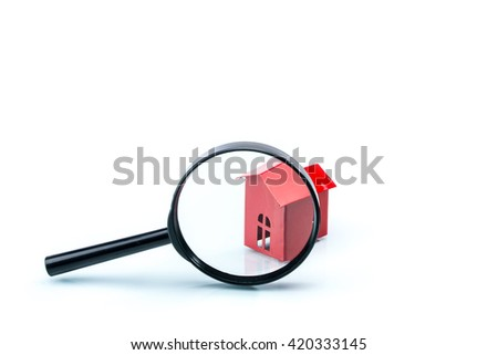 house scrutiny concept, house model with magnifying on white background - stock photo