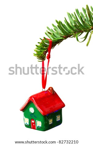 House shape bauble hanging on christmas tree