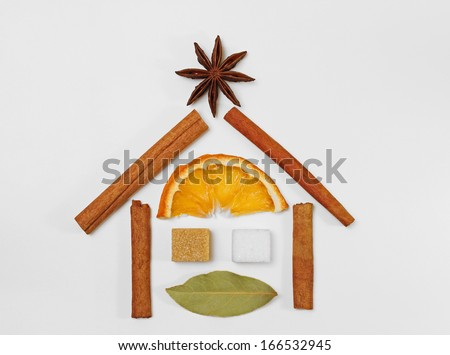 House shape decorative arrangement of mulled wine / punch / tea condiments - stock photo