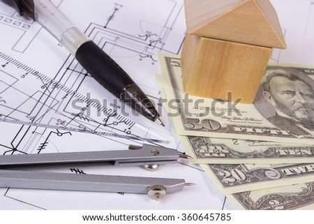 House shape made of wooden blocks, accessories for drawing and currencies dollar on electrical construction drawings, concept of building house, drawing for projects - stock photo