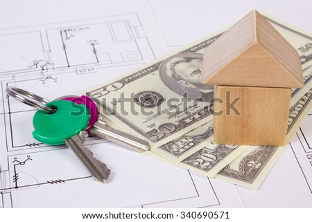 House shape made of wooden blocks, home keys and currencies dollar lying on electrical construction drawings of house, concept of building house, drawing for projects - stock photo