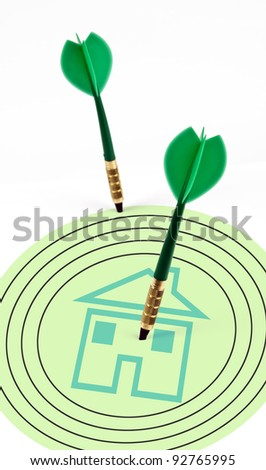 House shape on target with green arrows