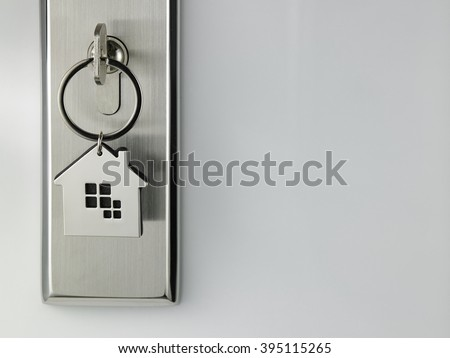 house shaped key chain at the door access - stock photo
