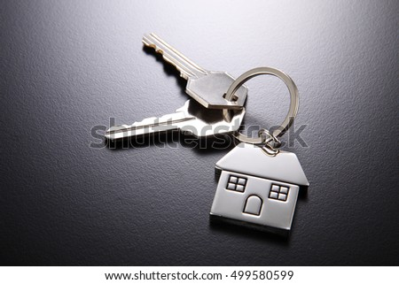 House shaped key chain isolated on black background