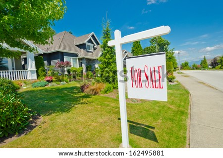House, sign for sale for big custom made luxury house in the suburbs of Vancouver, Canada. - stock photo