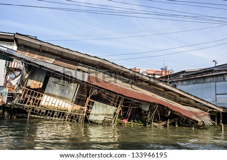 House sinking in Water - stock photo