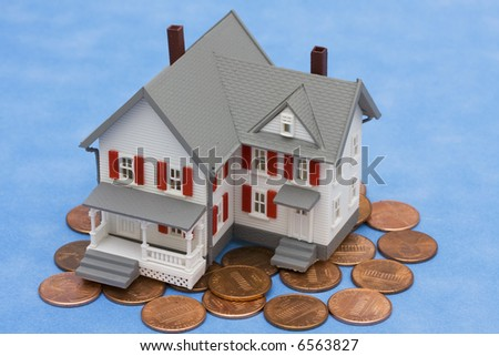 House sitting on pennies with blue background