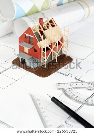 House structure an pencil on blueprint - stock photo