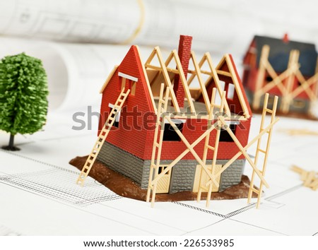 House structure and tree on blueprint - stock photo