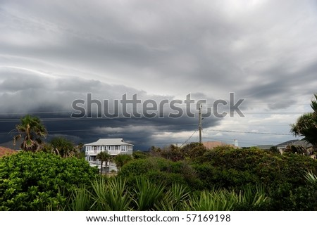 House surrounded by storm clouds