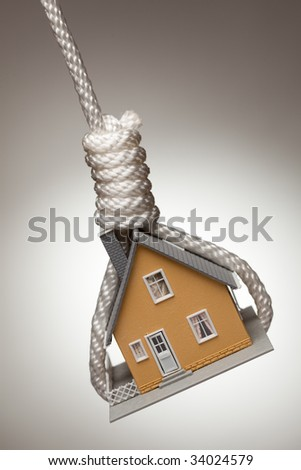 House Tied Up and Hanging in Hangman's Noose. - stock photo