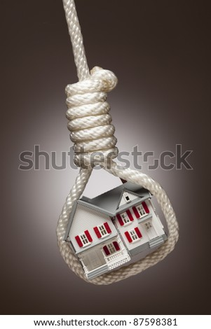 House Tied Up and Hanging in Hangman's Noose on Spot Lit Background. - stock photo