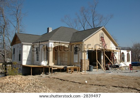 House under construction against blue sky - stock photo