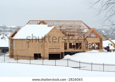 House under construction in winter setting