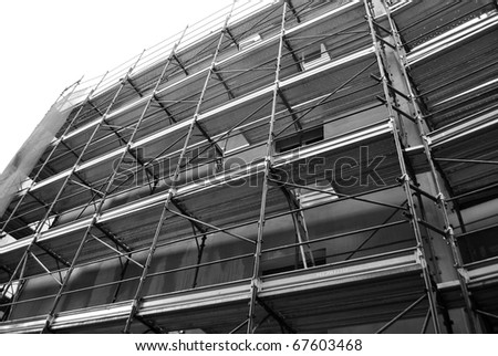house under construction with metal scaffolding