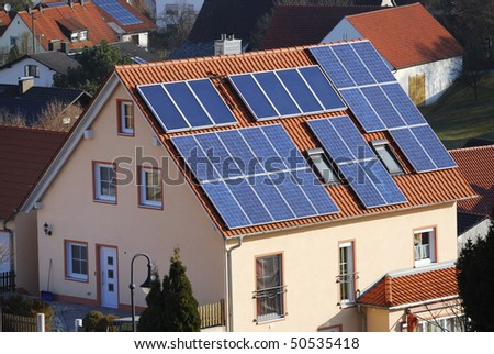 House using renewable alternative energy - stock photo