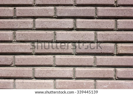 House wall element from a brown brick