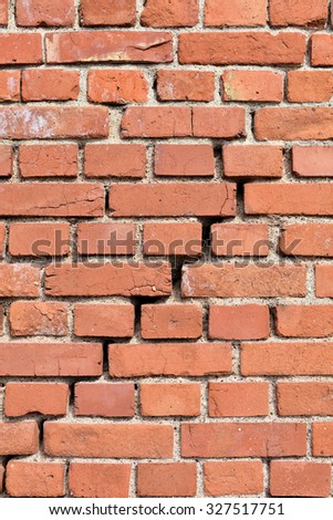 house wall with a crack in the middle - stock photo