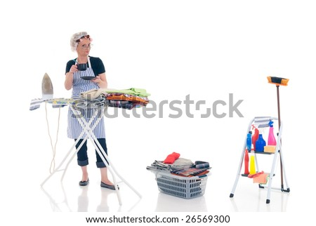 House wife, basket with ironed goods, ladder with cleaning products, daily household. - stock photo