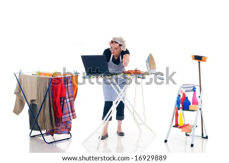 House wife, clothes line with washed clothing, ladder with cleaning products, daily household, chatting on laptop.