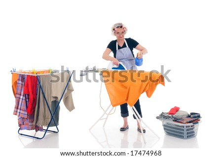 House wife, clothesline with washed clothing, basket with ironed goods,  daily household. - stock photo