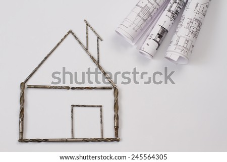 house with a drill bit tools - stock photo