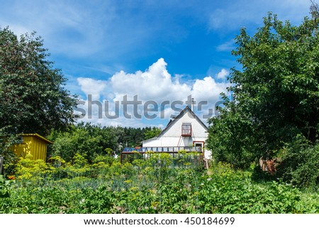 House with a garden in a village - stock photo