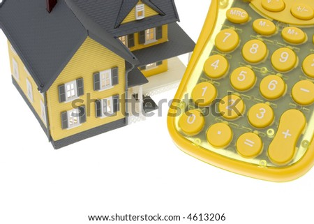 House with and calculator isolated on a white background - stock photo