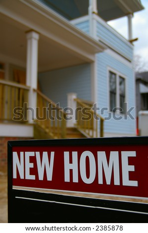 """House with closeup of """"new Home"""" sign - stock photo"""