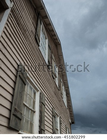 House with Dark Clouds