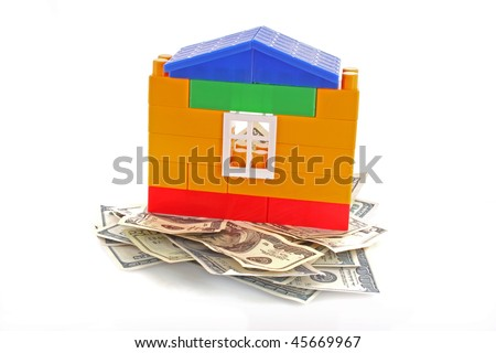 House with dollars on white - stock photo