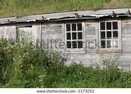 House with grass roof from before World War II. Hamningberg is well preserved, abandoned fishing village in, eastern Finnmark, Norway