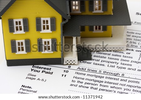 House with money and tax paper – us schedule A form - stock photo
