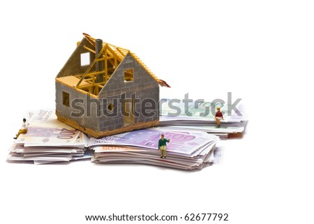 House with money over white background - mortgaging concept - stock photo