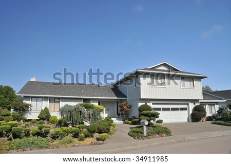 House with nice  landscaping, mailbox - stock photo