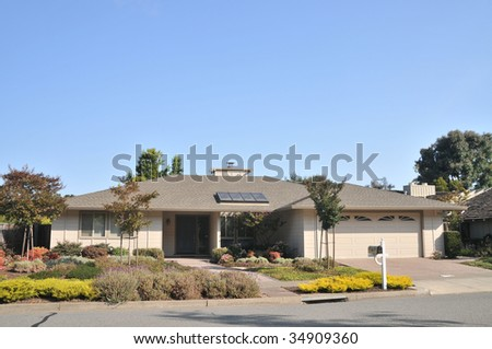 House with nice  landscaping, mailbox, skylight - stock photo