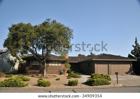 House with nice  landscaping, tree, mailbox - stock photo