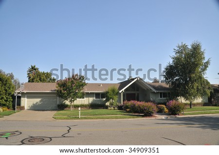 House with nice  landscaping, trees, mailbox, basketball hoop - stock photo